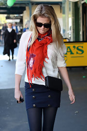 Actress Rachel Taylor was seen out and about in a stylish scarf and sailor inspired navy skirt. She topped her look off with a black cross body bag.