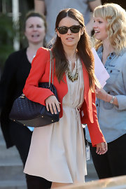 Rachel Bilson looked elegant carrying a timeless black leather quilted purse with a dangling logo and gold chain strap.