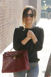 Rachel Bilson looked fetching as ever carrying a highly coveted Peekaboo tote. The red purse popped against Rachel's black and gray attire.