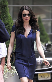 Rachel Weisz rocked picture-perfect curls while out in New York City. She wore a casual blue dress and finished off the look with a chain-strap bag.