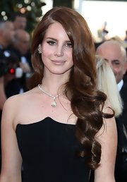 Lana Del Rey styled her ultra-long locks in shiny soft curls for the the opening ceremony of the Cannes Film Festival.