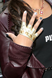 Eve accessorized with a studded gold fingerless (and palmless) glove at the Gumball 3000 Rally.