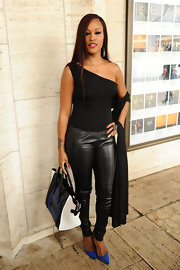 Eve wowed during Fashion Week in black leather skinnies and a one-shoulder top.