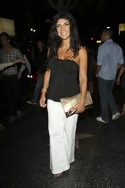 Teresa Giudice looked sharp in a black bandeau top with white pants.