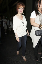 Caroline Manzo achieved a youthful and stylish look with her scoopneck sweater and jeans combo.