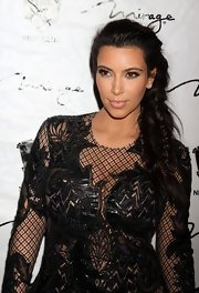 Kim wore her raven tresses braided down to the side on NYE 2013.