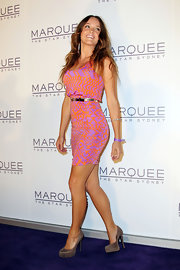 Rebecca Breeds paired basic taupe platform pumps with her vibrant dress at the Marquee grand opening.