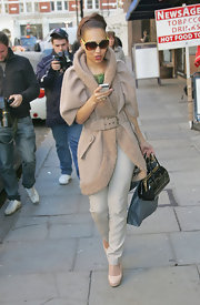 Rebecca Ferguson looked stunning on the streets of Covent Garden in a tan fleece coat with a shawl collar and puffed sleeves.