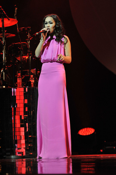 Rebecca Ferguson performed at a concert wearing a sleeveless pink evening dress that was equal parts sweet and elegant.