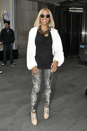 Eve was out and about in Manhattan wearing a busy ensemble, topped off with a pair of round sunnies.