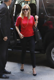 Reese Witherspoon chose a bright red crewneck with three-quarter length sleeves for her look while out in NYC.