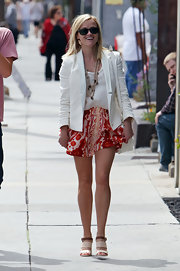 Reese looked street chic in this red floral-print mini while out in Venice Beach.