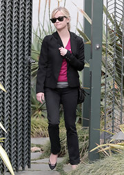 Donning a cool pair of Wayfarer sunglasses, Reese is seen leaving a friends house while looking oh-do-stylish.