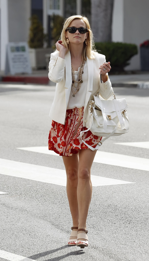 Reese Witherspoon, looking stylish in a white blazer, heads out around Santa Monica.