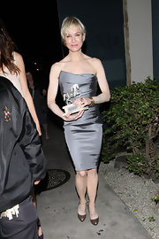 Renee looks so petite in this tiny silver cocktail dress.