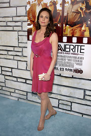Diane Lane paired her pink cowl neck dress with dainty nude sandals.