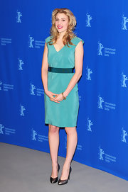 Greta Gerwig finished off her simple yet elegant look with a pair of pewter pumps.