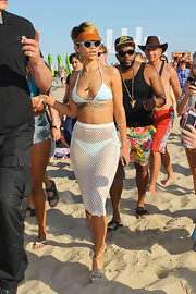 Rihanna chose a powder blue string bikini to show off her killer figure while out at the beach.