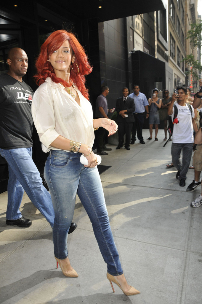 "Rihanna is all smiles, sporting a Fendi clutch, as she leaves her hotel in New York City. The 23 year old ""What&squot;s My Name"" singer performed in Long Island last night as part of her &squot;Loud&squot; tour."