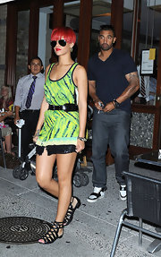 Rihanna stood out in a neon tie dy mini with leather gladiator sandals.