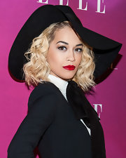 Rita Ora brought out the drama with this wide-brimmed floppy hat that matched her black frock perfectly.