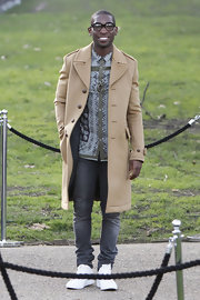 Tinie Tempah showed off his classic style with this tan wool coat while attending London Fashion Week.