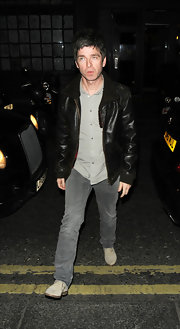 Noel Gallagher looked cool and stylish in a retro-styled bomber jacket.