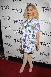 Rita Ora chose a pair of knee-high suede boots with studs for an edgy and rock-inspired look at the Tao nightclub.
