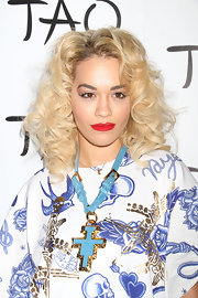 Rita Ora added a pop of turquoise to her already loud look with this large turquoise pendant necklace with a matching buckled chain.