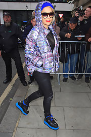 Rita bundled up in this '80s paint-splattered jacket for an outing in London.