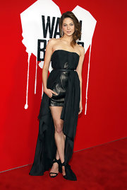 Analeigh Tipton looked edgy in this black leather gown with an overlay high-low hem.