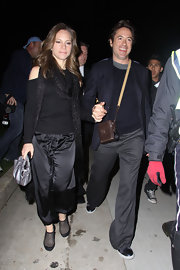 Susan Downey looked funky in her all-black ensemble, consisting of a sweater with shoulder cutouts, a glittery scarf, and harem pants, during a party to kick off Oscar weekend.