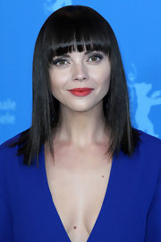 Christina Ricci wore her tresses shiny and pin-straight with blunt brow-length bangs at a photocall for 'Bel Ami.'