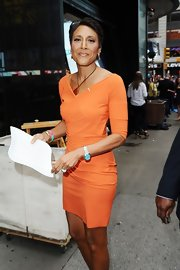 Robin Roberts looked trim and stylish in her orange dress.