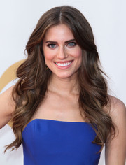 Allison's styled her long dark locks into simple, wavy curls.