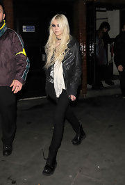 Taylor furthers her tough look with a leather motorcycle jacket.