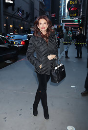 Roma Downey bundled up in this black down jacket while attending 'Good Morning America.'