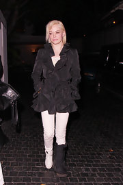 Rose McGowan chose to dress up her evening look with this belted black evening coat with ruffles.