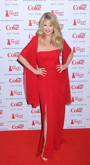 Christie Brinkley donned a red chiffon gown with a shawl to the Heart Truth fashion show.