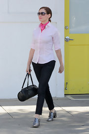 Rose McGowan left a salon in Beverly Hills wearing a pair of metallic pewter slip-on loafers.