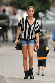 Roxy Olin gave her downtown street vibe an edgy spin with black ankle boots.