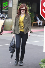 Rumer Willis added polish to a low-key street look with a black leather bag.
