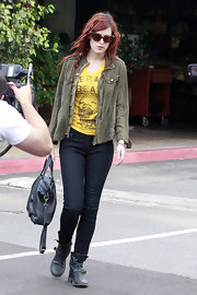 Rumer Willis accessorized with black leather boots complete with buckled detailing.
