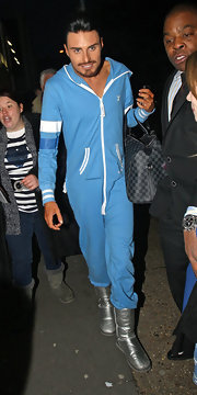 Ryan Clark wore a pale blue onesie with a zip-up front and silver sheepskin boots for a unique look while out in London.
