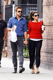 Eva Mendes took a leisurely NYC stroll holding hands with Ryan Gosling wearing a bright red scoopneck sweater layered over a white tee.