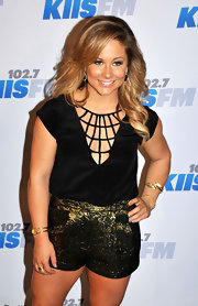 Shawn Johnson wore a sultry black blouse with a spiderweb neckline to the Jingle Ball.
