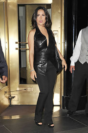 Salma looked hot in a leather, halter vest with a plunging neckline.