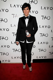 Kris Jenner suited up at TAO in a black tuxedo complete with a sharp bow tie.