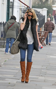 Sarah Harding glamorized her jeans and sheer T-shirt with a black furry vest.