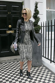 Sarah Harding jazzed up a graphic print dress with a ruffled leather jacket.